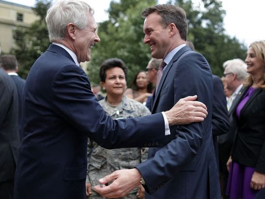 Navy Secretary Ray Mabus, left, laughs with Army Secretary Eric Fanning during a the Pentagon's annual LGBT pride celebration June 8. Fanning is the Defense Department's first openly gay service secretary.