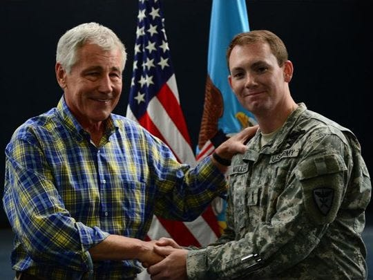 Muller met Defense Secretary Chuck Hagel in 2014.