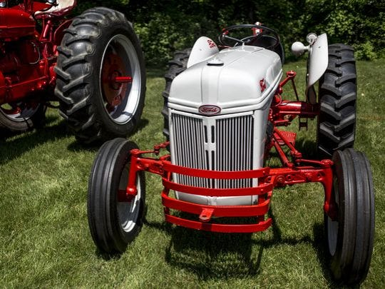 A Ford tractor is displayed during an antique tractor