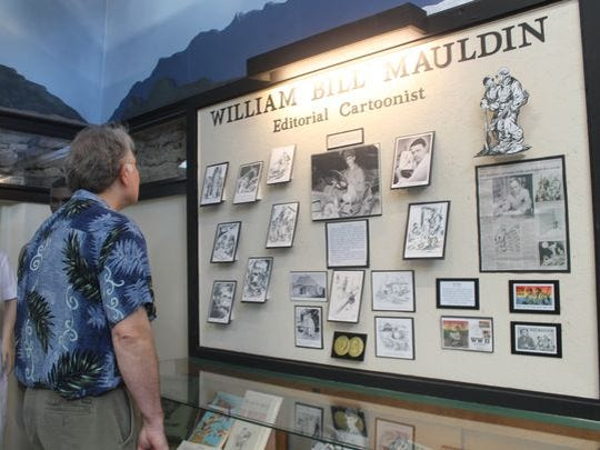 "A display of William ""Bill"" Mauldin's famous editorial cartoons from World War II is in the Korean War exhibit. Mauldin was from Otero County and rose to fame for his cartoons, earning himself two Pulitzer Prizes for his work."