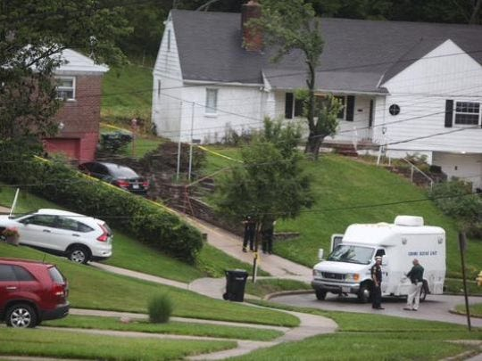 Cincinnati police in July 2015 investigate a Westwood home in which they found one man dead and another injured after a reported home invasion and robbery.
