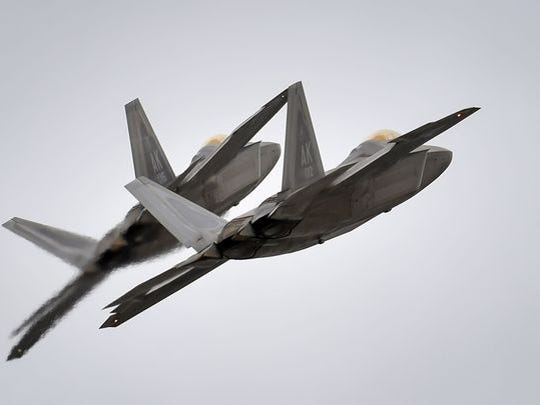 Two F-22 Raptors from Joint Base Elmendorf-Richardson, Alaska's 3rd Wing conduct approach training March 24.