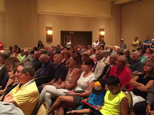 A portion of a crowd that turned out July 26 to hear about Mane USA's plans - now withdrawn - to build a manufacturing plant on American Road in Morris Plains.