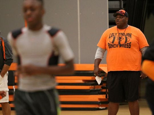 Lely coach Maurice Belser instructs his team during the first day of practice Monday, Aug. 1 at Lely High School