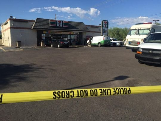 Phoenix police were investigating a robbery and fatal shooting at this 7-Eleven  near 16th Street and Southern Ave.