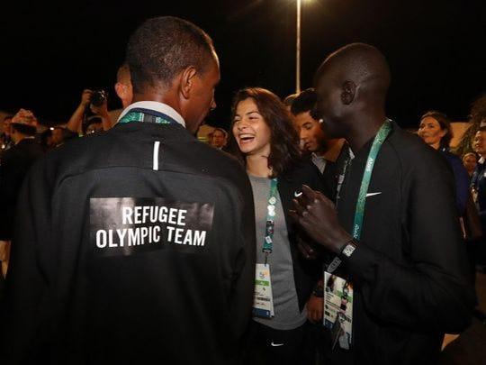Yusra Mardini, center, of Syria with fellow team members in Rio on Aug. 3, 2016.