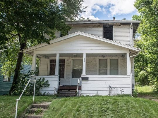This blighted home at 84 Riverview Ave. in Battle Creek
