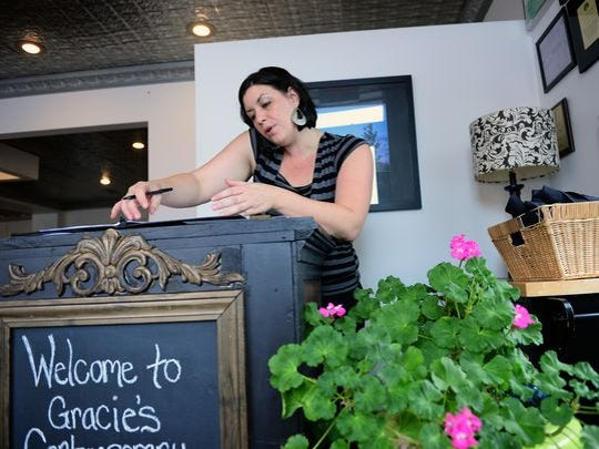 Manager Emily Gray takes a reservation at Gracie's