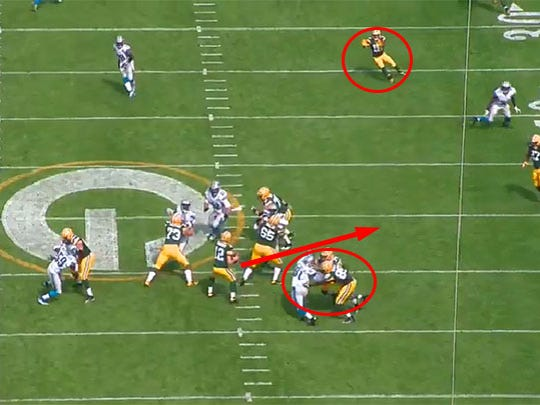 Randall Cobb comes free and Aaron Rodgers just needs to get out of the pocket to make the throw.