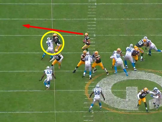 Glover Quin blows up the block of running back Eddie Lacy, forcing Rodgers to roll out of the pocket.