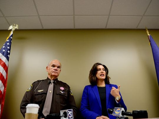 Ingham County Prosecutor Gretchen Whitmer and Ingham County Sheriff Gene Wriggelsworth hold a press conference Tuesday, Oct. 11, 2016, to announce the arrest and arraignment of David Hovarter, 47, a Leslie school teacher and girls cross country coach, on multiple charges of sexual assault of a child.