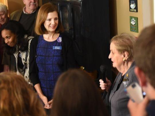 Lisa DiRado watches as former Secretary of State Madeleine