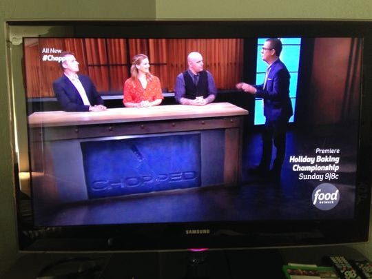 "Food Network's ""Chopped"" judges (L-R). Mark Murphy, Amanda Freitag, Chris Santos and host Ted Allen."