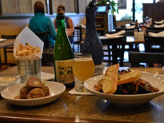 Potato frites, stuffed meatballs and mussels at Pig + Fish.