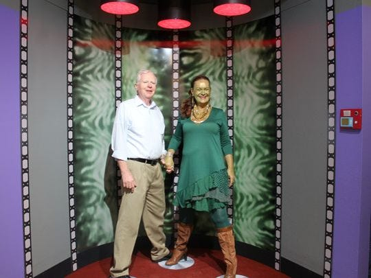 Alamogordo residents pose for their photo to be taken inside the exhibit's transporter. The Star Trek exhibit will be on display for one year.