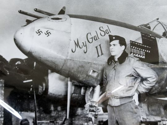 Retired Gen. Seth McKee, then a lieutenant colonel, stands next to his P-38 Lightning, named for his wife, during World War II. The two swastikas represent German planes he shot down before D-Day. McKee died Dec. 26, 2016. He was 100.