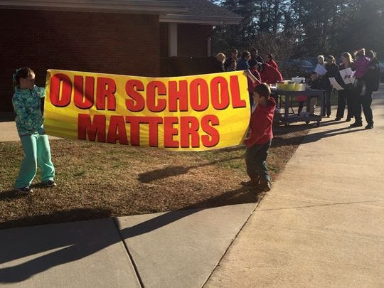 The School District of Pickens County closed A.R. Lewis and Holly Springs elementary schools last year, with officials saying the move would save millions over the next several years. The closures drew protests from parents and students at the schools.