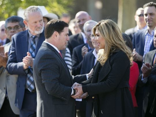 Gov. Doug Ducey shakes hands with the governor of Sonora, Mexico, Claudia Pavlovich Arellano, at the Capitol in Phoenix on Nov. 29, 2016.