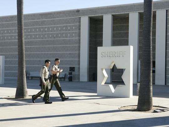 Two sheriff's deputies walk past the Murrieta jail, where drug dealer Brandon Richard Anderson is currently incarcerated.
