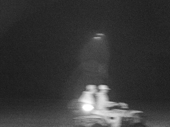 Trail camera photo of two suspects in the illegal killing