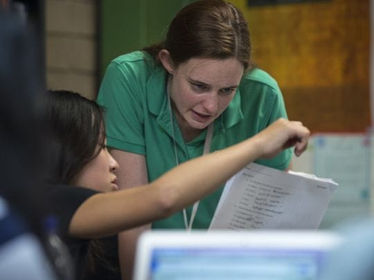 Chemistry teacher Lauren Cooney works with Michelle Koo (left) on April 25, 2017, in their classroom at BASIS Scottsdale, Ariz.
