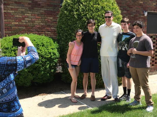 After mass at the Church of the Guardian Angel in Allendale, Former FBI Director James Comey posed for a photograph with Northern Highlands Regional High School students. Comey's wife, Patrice Failor, is taking the photograph.
