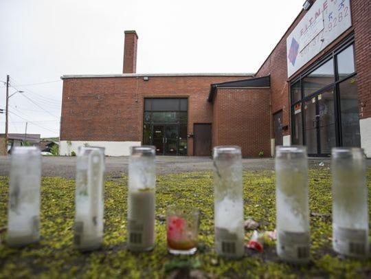 A memorial outside 221 Main St. in Binghamton where