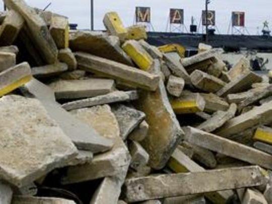 Rubble surrounds the Pennsauken Mart during its demolition