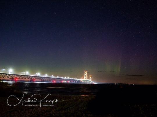 The Mackinac Bridge underneath the northern lights