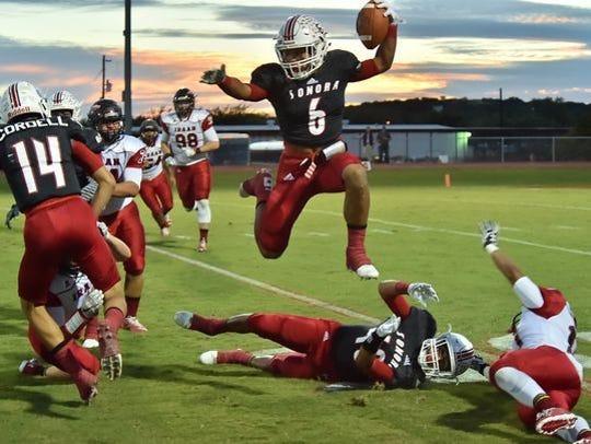 Jarrett Jackson soars for a touchdown last year against