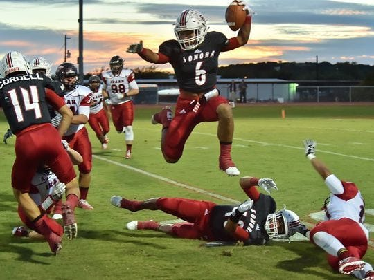 Jarrett Jackson soars for a touchdown last year against Iraan. The dynamic running back rushed for 1,248 yards and had 981 receiving yards for a combined 35 touchdowns.