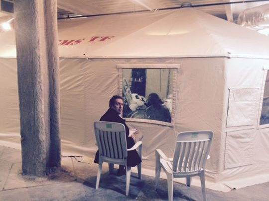 Quarantined nurse Kaci Hickox meets on Oct. 26, 2014 with attorney Norman Siegel, seated, at the isolation tent in Newark, N.J.