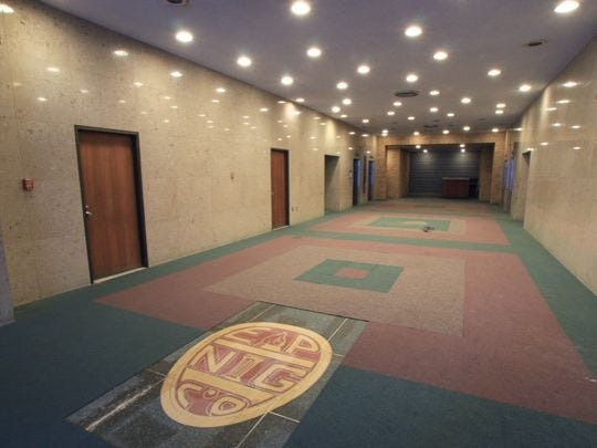 An old El Paso Natural Gas logo is on the ground floor of the Blue Flame building.