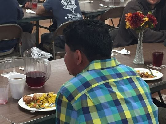 A guest enjoys dinner at Table of Hope community soup kitchen in Morristown in June 2017.