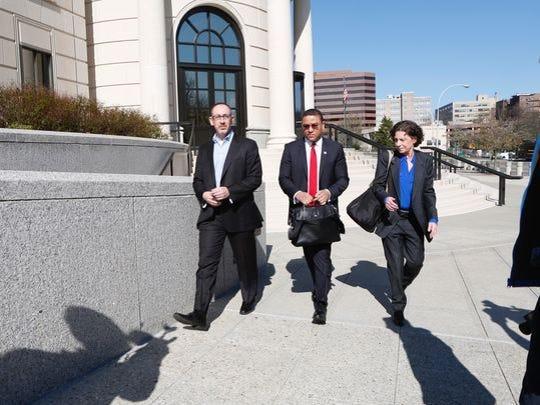 Aaron Troodler on the left enters the federal courthouse in White Plains