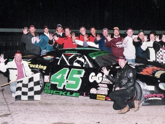 Rich Bickle and his race team crew and family celebrate