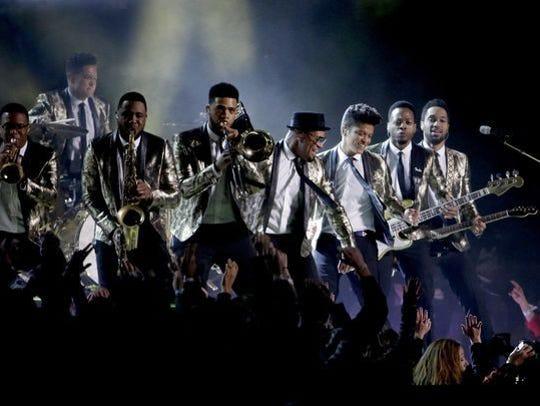 Trombonist Kameron Whalum performs with Bruno Mars