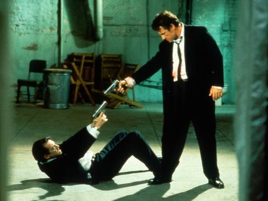 "Mr. Pink (Steve Buscemi, left) and Mr. White (Harvey Keitel) are at an impasse in ""Reservoir Dogs."""