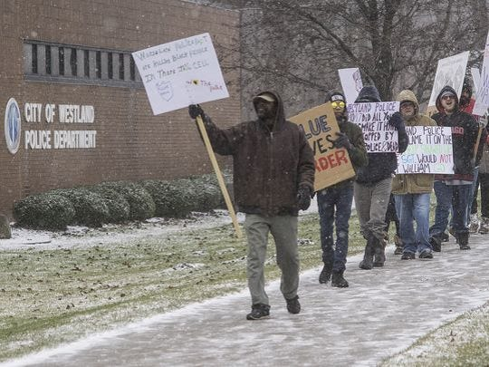 Demonstrators in front of the Westland Police Department in January protest the death of William Marshall, who died of cocaine toxicity last December while in police custody. A hearing for three former city employees charged in the case will continue in January.