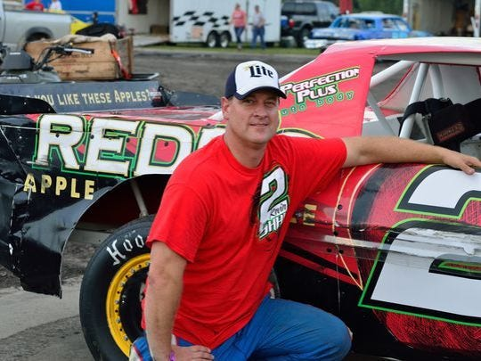 Kevin Sharp poses for a photo prior to a stock car race at Adams County Speedway in Corning, Iowa.