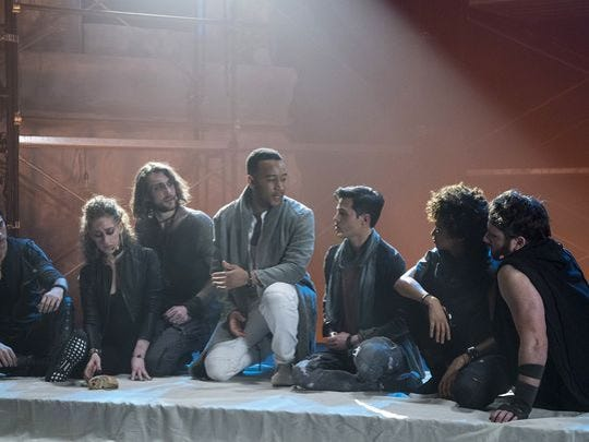 "Pop singer John Legend, kneeling, performs the title role in the live version of ""Jesus Christ Superstar"" on NBC this Easter Sunday."