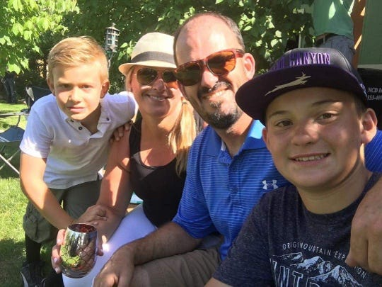 Gavin Myers, 13, (right) poses with his family. He