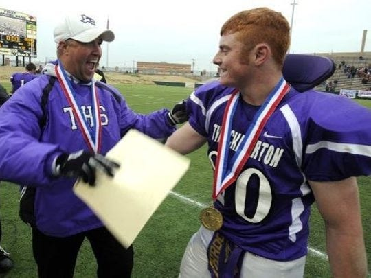 Mike Reed celebrates after coaching Throckmorton to the state title.