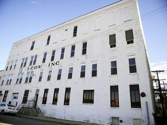 Bi-Comps letters reflect the neglected building's shape