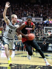 Jacksonville State forward Kayne Henry (11) drives to the basket defended by Purdue forward Evan Boudreaux during an NCAA college basketball game Saturday, Nov. 23, 2019, in West Lafayette, Ind. (AP Photo/R Brent Smith)