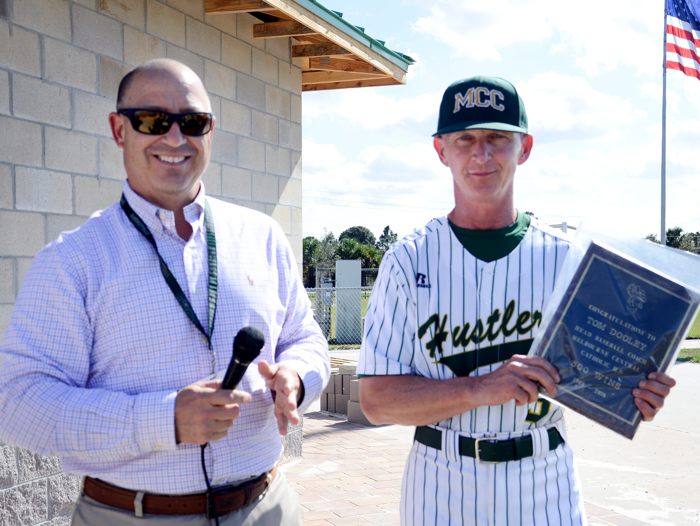 MCC athletic director Mike Riazzi and baseball coach Tom Dooley during Tuesday's game in Melbourne. Dooley was honored for winning his 500th game last week.