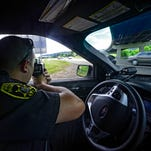 Broome County Sheriff's deputy Matthew O'Brien, of the Binghamton area, uses a radar gun to look for people speeding on the Route 81 northbound. The interstate passes through the Town of Chenango, one of top 10 towns in New York where tickets are issued.