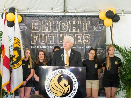 UCF President John C. Hitt speaks on the contributions