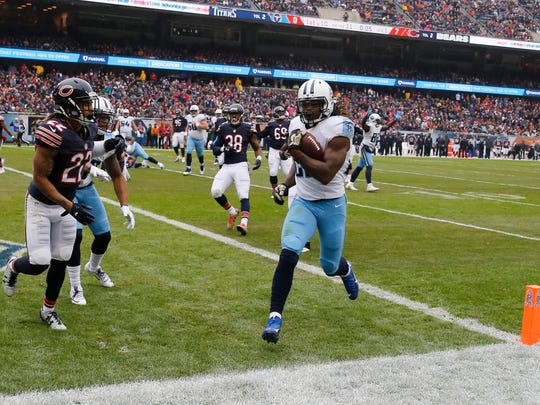 Tennessee Titans running back Derrick Henry (22) runs for a touchdown during the first half of an NFL football game against the Chicago Bears, Sunday, Nov. 27, 2016, in Chicago.