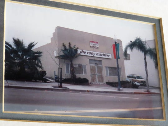 A photo displayed at Winchesters Grill & Saloon in downtown Ventura shows what the building looked like in its previous life as The Copy Machine.
